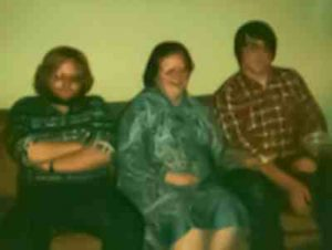 Photo of me, stoned, with my mom and brother at a family gathering that I was obviously not happy to be attending.