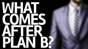 """Photo of the phrase, """"What Comes After Plan B?"""" written on a board with a faded picture of a man in a suit coat in the background."""
