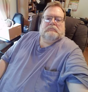 Photo of me in my desk chair at the start of my public weight loss journey.