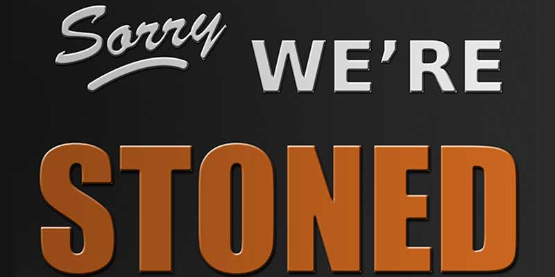 """Photo of a sign that reads, """"Sorry We're Stoned."""""""