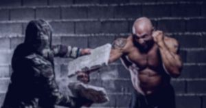 Karate man smashing cement slab, symbolizing me smashing goals and barriers.